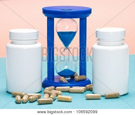Scattered Capsules With White Jars And Hourglass