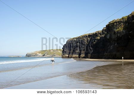 Tourists In Ballybunion Beach And Cliffs