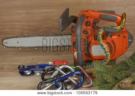 Chainsaw on a wooden background. Small saw for pruning. Tool for arborists.