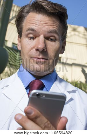 Doctor Reviewing Smart Phone Messages