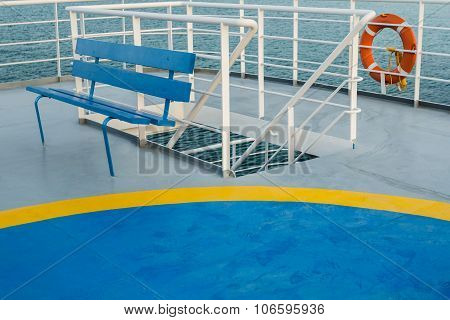 Empty Upper Deck With Blue Wooden Bench And Helicopter Pickup Point On Greek Ferry