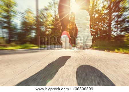 Woman Jogger Running Down The Road
