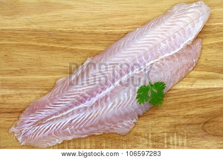 Fillet of Fresh water fish, Pangasius on a wooden background