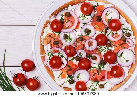 Scandinavian Salmon Pizza With Cream Cheese, Capers, Tomato And Onion.