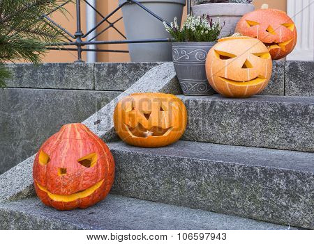 Halloween pumpkin candle holders on the stairs
