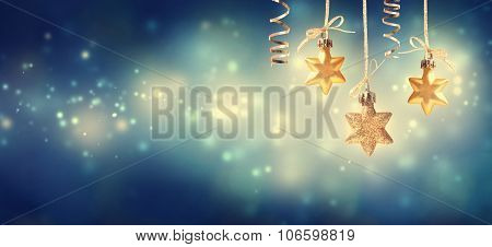 Christmas Golden Star Ornaments At Night