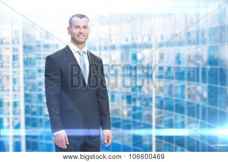 Half-length portrait of smiley business man, blue background