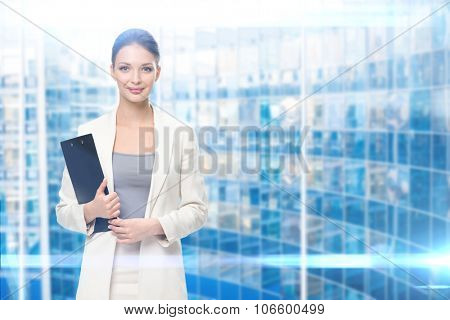 Portrait of businesswoman handing black documents, iblue background. Concept of leadership and success