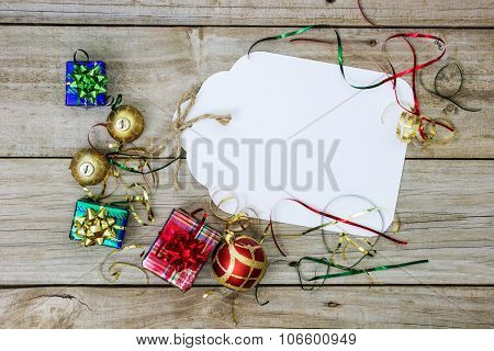 Blank tag with holiday decor on wood table