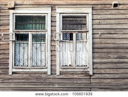Fragment Of Old Rural Wooden Wall With Windows