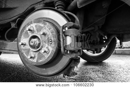 Replacing Wheel On A Car, Close-up Monochrome