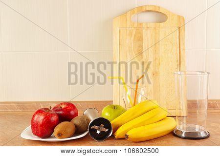 Fresh fruit glasses and blender to prepare dessert fresh