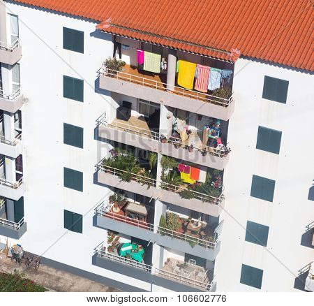 Up view of dwelling house, balconies with laundry, Portugal, Madeira