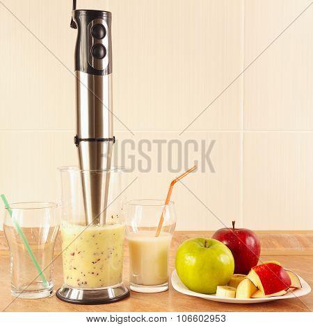 Preparing milkshake with fresh fruits in blender