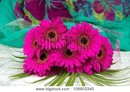 Bouquet Of Purple Gerber With A Green Background On The Marble Table