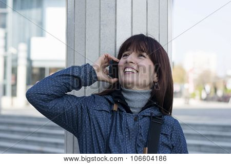 Woman In Blue Jacket Using Her Phone