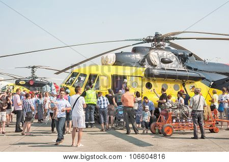 People explore the MI-10K helicopter