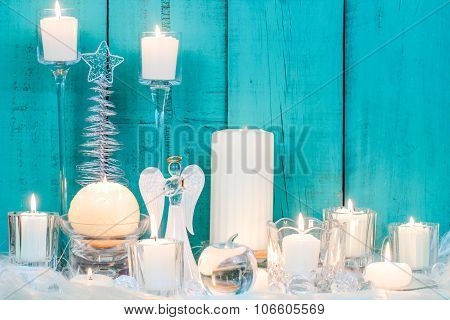 Christmas decor and candles by wood background