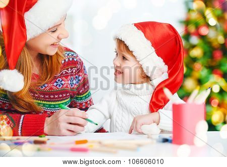 Happy Family Mother And Child Daughter  Write Aletter To Santa On Christmas