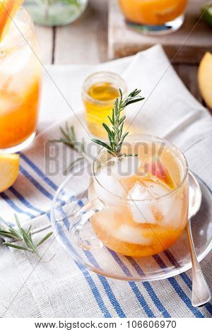 Peach and rosemary fizz cocktail on a wooden background. Cocktail.