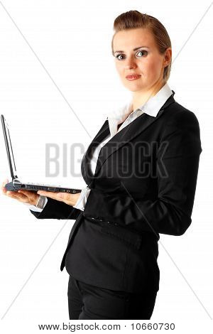 modern business female holding laptop in hand