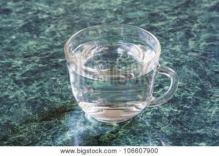 Cup with clear water.