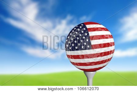 Golf ball with United States flag colors sitting on a tee