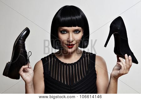 Woman In Doubts With Heels Or Flat Shoes