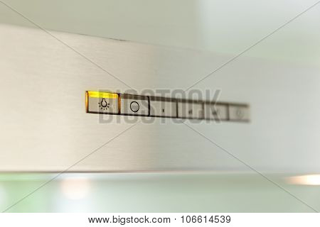 closeup of a modern inox cooker hood, switch