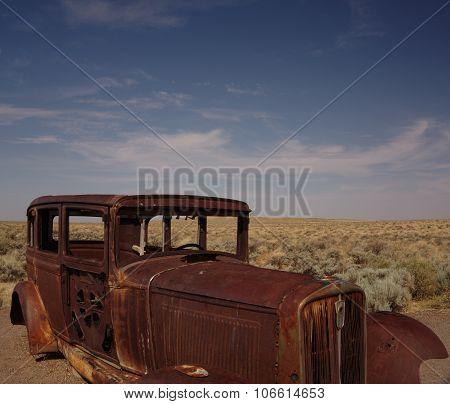Abandoned car in the desert