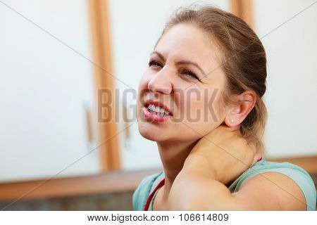Overworked Woman Suffering From Neck Pain.