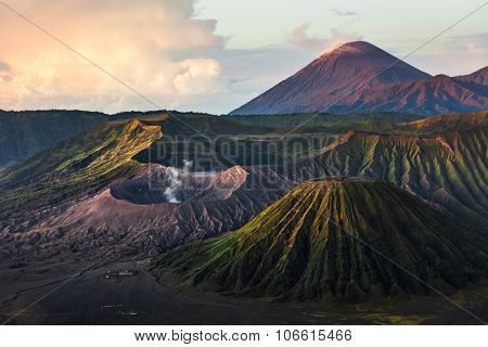 Group of volcanoes in the National Park of Java island, Indonesia. Bromo (smoking), Batok, Semeru volcanoes