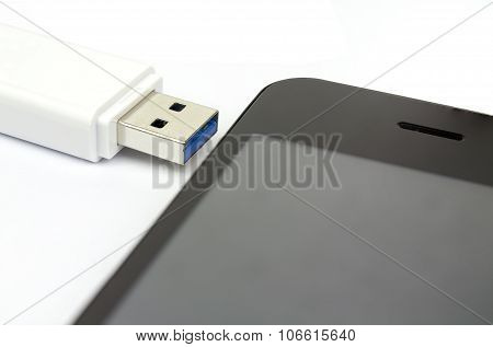 Usb Flash Drive 3.0 And Smart Phone On White Background, Data Sharing Concept