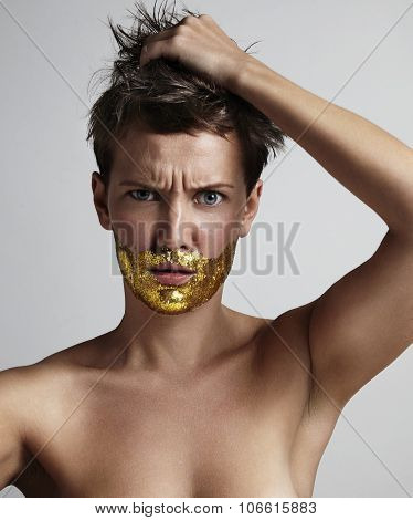 Nude Woman With A Golden Gliter In A Shape Of Beard