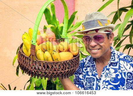 Asian Man Selling Fruit From A Basket