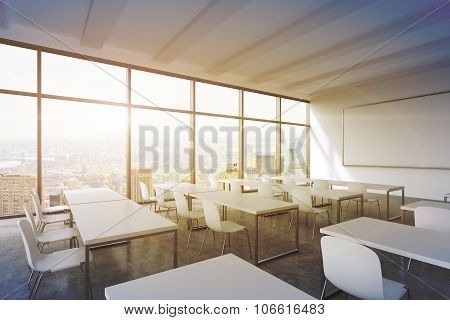 A Modern Panoramic Classroom With New York View. White Tables And White Chairs. 3D Rendering. Sunset