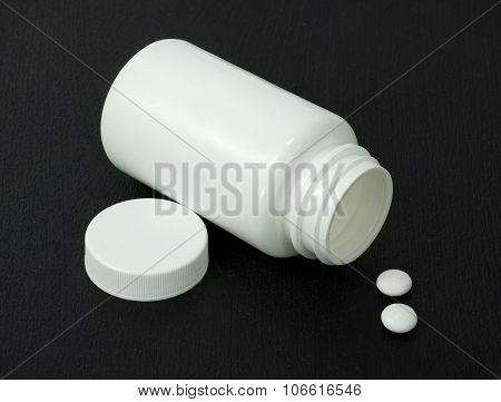 Two White Pills With White Jar
