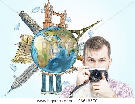 A Handsome Tourist With Camera And A Globe With Sketched Famous Places. Light Blue Background. Eleme