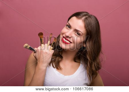Beautiful Woman With Cosmetic Brush