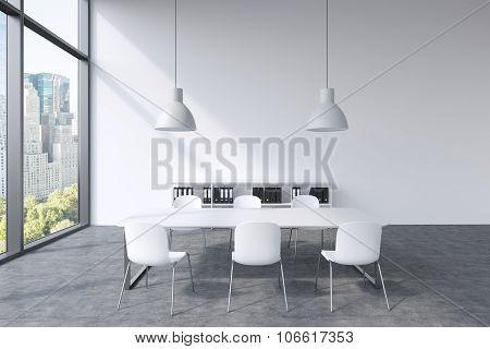 A Conference Room In A Modern Panoramic Office With New York View. White Table, White Chairs, A Book