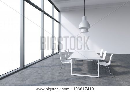 A Conference Room In A Modern Panoramic Office With Whit Copy Space In The Windows. White Table, Whi