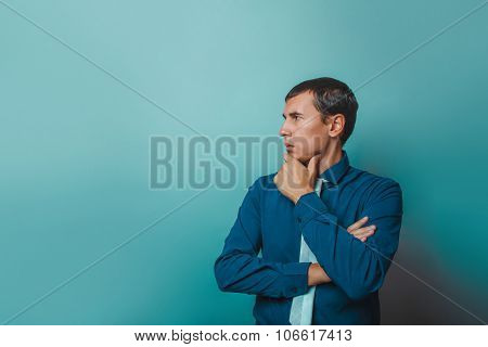 a  man of European appearance thirty years thinking hand on chin