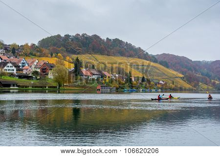 Kayakers on the river Rhine at Eglisau, Switzerland.