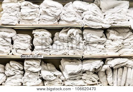 Messy Sheets On Shelves