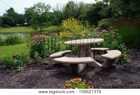 Picnic Table in a Flower Garden