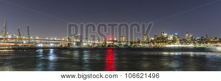 Skyline Of Brooklyn With Brooklyn And Manhattan Bridge  By Night
