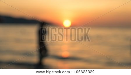 Blurred Image Of The Sunset On The Beach