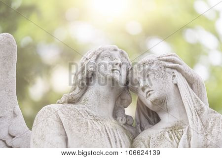 Sculpture Of Two Angels In Backlit