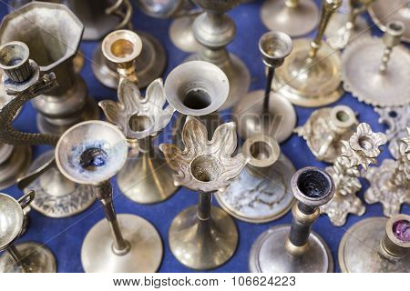 Many Old Silver Candle-stands On A Flea Market