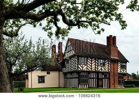Medieval Tudor house in Birmingham UK Blakeslay Hall exterior view of the garden